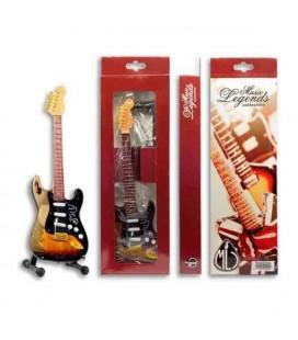 Imagem de uma miniatura de guitarra elétrica no suporte e da embalagem